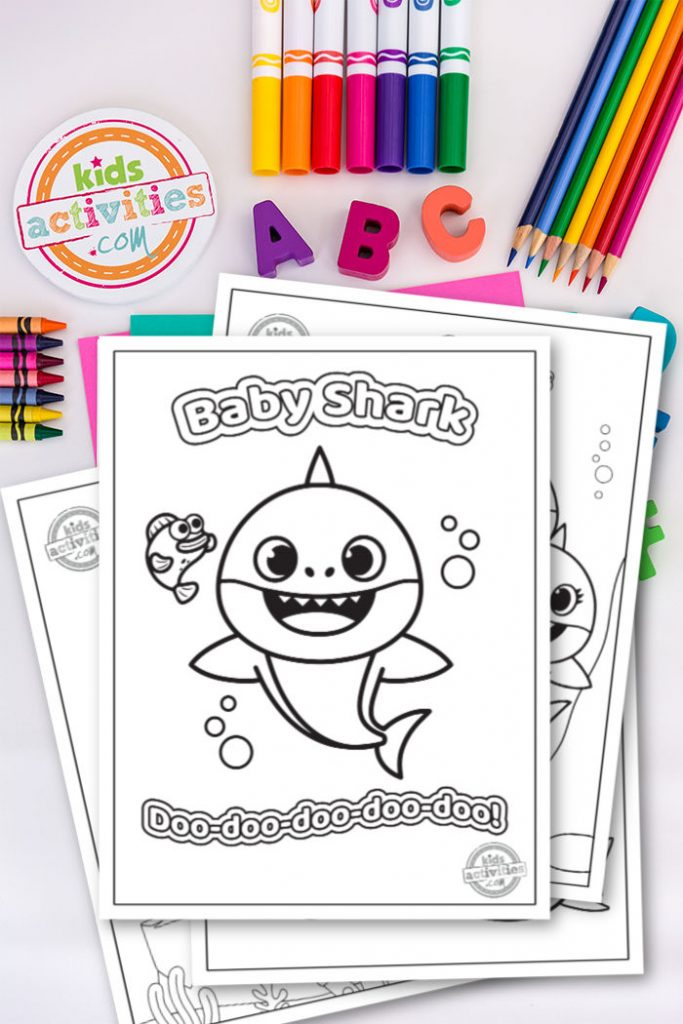 cute dancing baby shark characters ready for children to color with crayons or markers