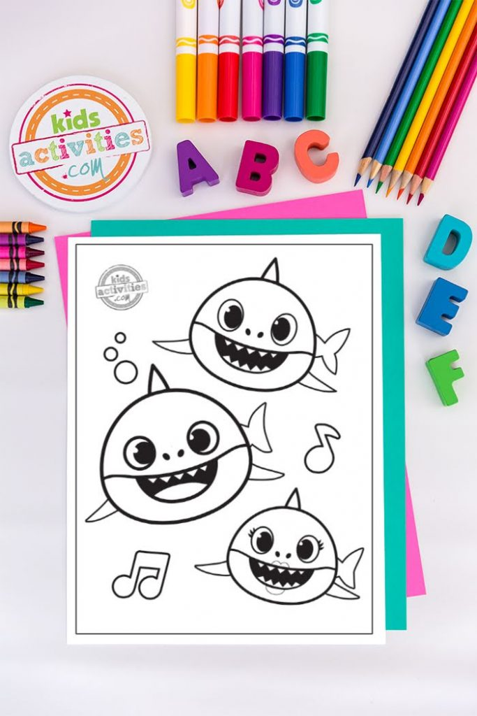 Baby Shark, Daddy Shark, and Brother Shark singing and dancing on coloring page