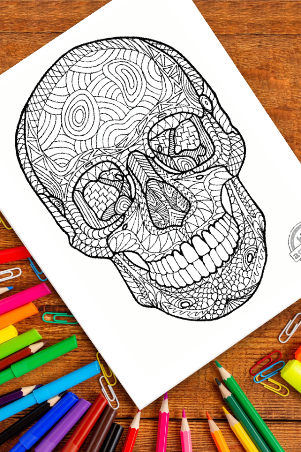 intricate human skull zentangle pattern art ready to be colored with mixed art supplies and bright colors