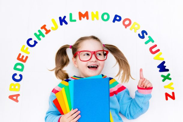 Letter R - preschool girl with entire alphabet and book pointing to letter r