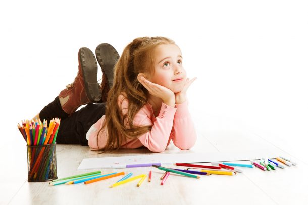 Trace the letter C - preschool girl with colored pencils doing a alphabet worksheet