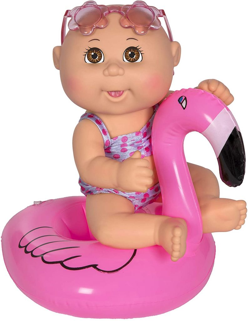 swimming doll with brown eyes and a flamingo float