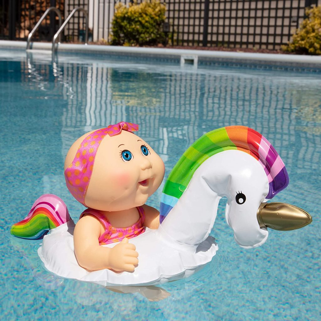 Cabbage Patch Swimming Doll with Unicorn Float in the backyard pool