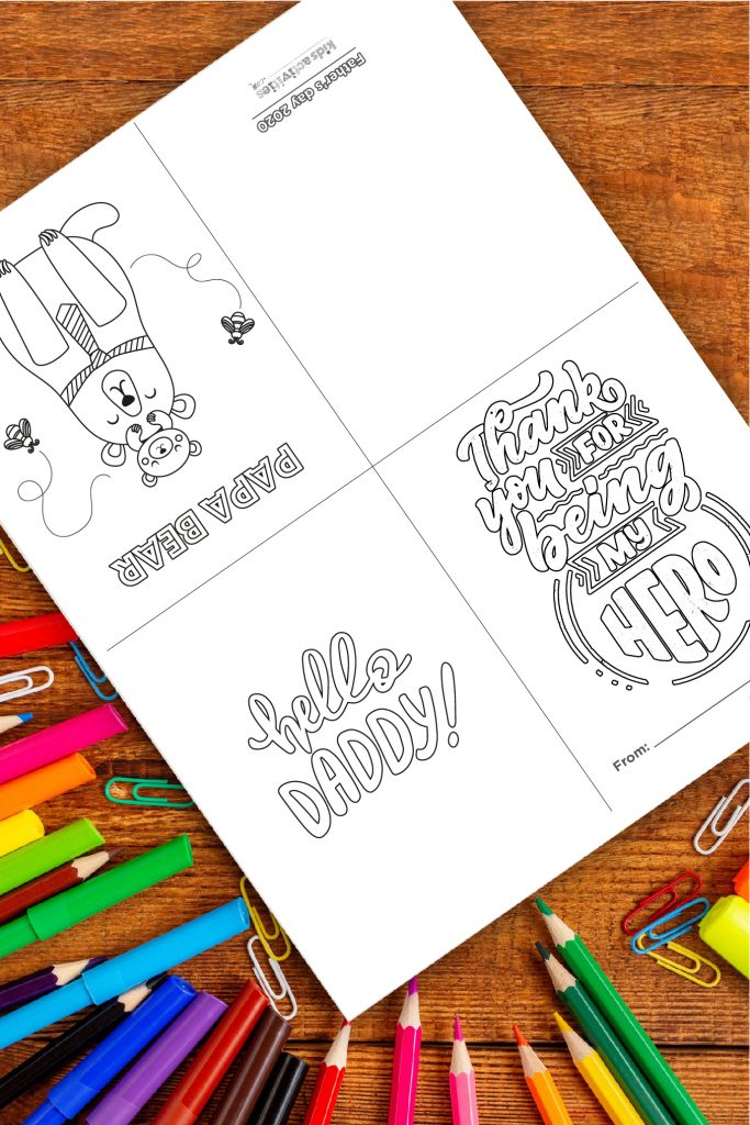 Free fathers day printable cards pdf shown on wood background - trifold card for paper or cardstock to be colored by kids and then folded for dad