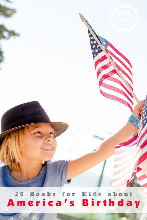 A young girl with a black hat on is holding an American flag in her left hand.
