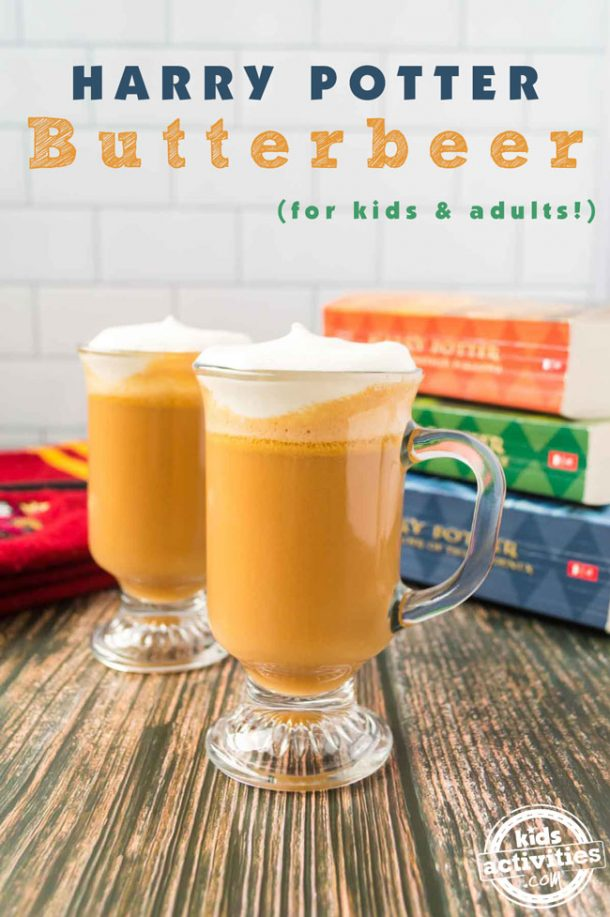 Two mugs of butterbeer topped with whipping cream along with a stack of three Harry Potter books.