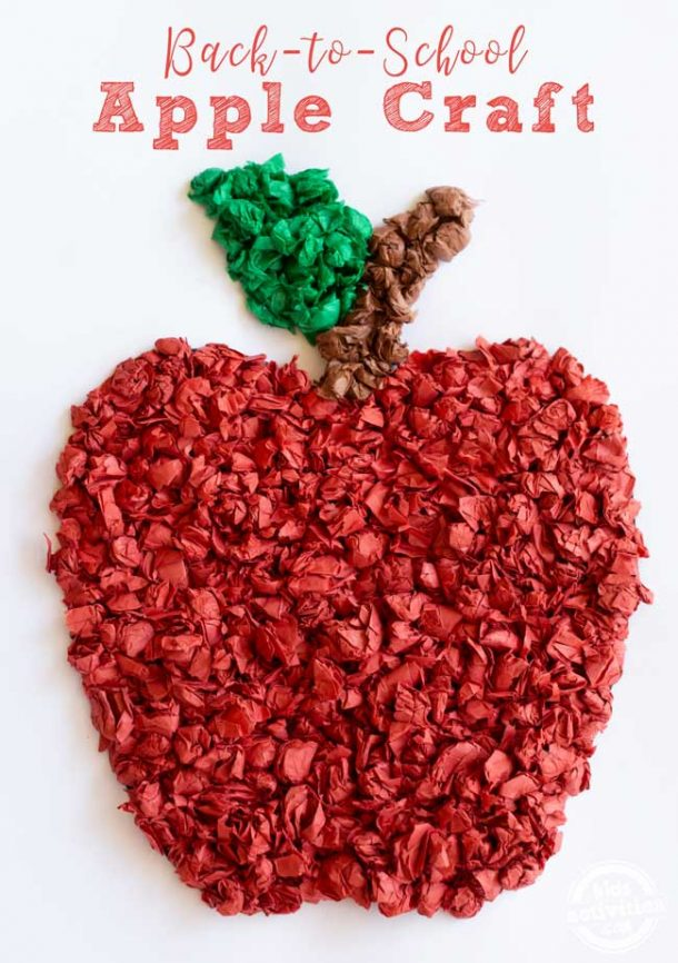 A red apple created using red tissue paper, green tissue paper and brown tissue paper.