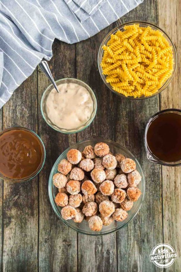 Slow Cooker Swedish Meatballs Recipe ingredients - Sitting atop a wood backdrop are five bowls containing all the ingredients you need to make slow cooker Swedish meatballs.
