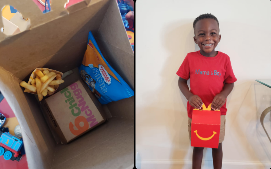 Inside the happy meal with Tanesha's son holding the box looking very happy.