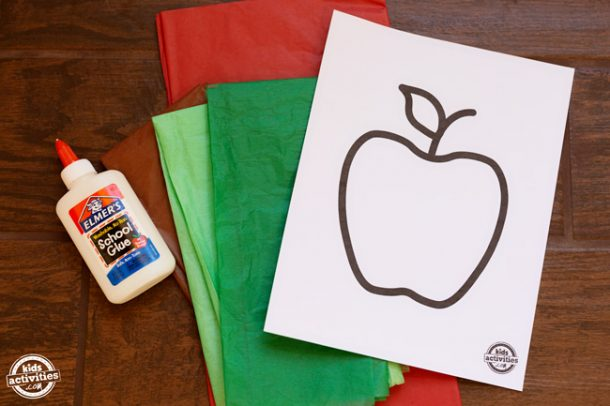 White glue, apple printable on white cardstock and red, green, and brown tissue paper.