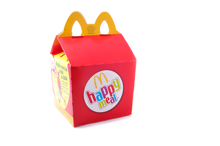 Happy meal box that is red and yellow with rainbow letters.