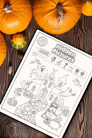 Halloween hidden pictures coloring page activity on a wood table surrounded by small pumpkins