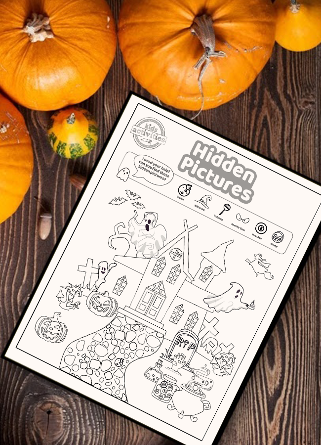 Halloween hidden picture coloring page activity on a wood surface surrounded by small pumpkins