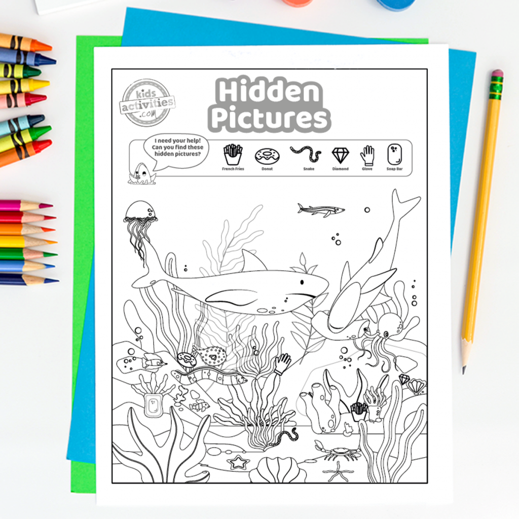 printable puzzles - hidden pictures in the ocean - shark, jelly fish and more pictured
