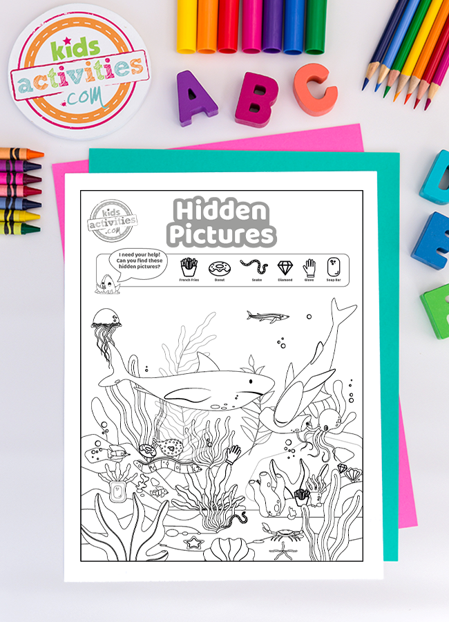 Shark Week Hidden picture puzzles - shown is the free printable with instructions plus colored paper and markers all from Kids Activities Blog