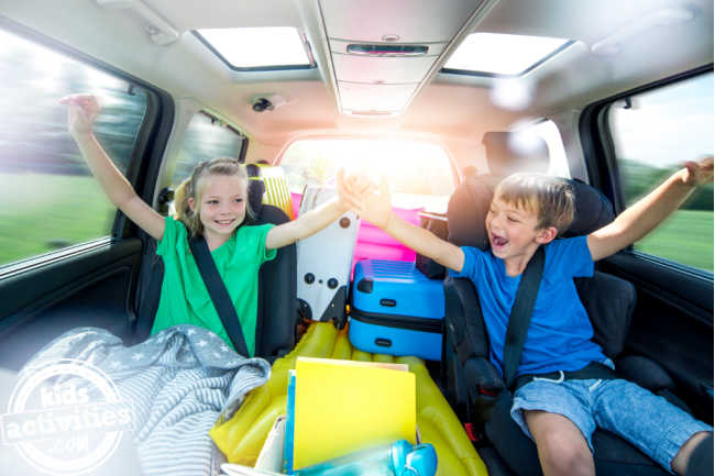 kids in the car wearing seatbealt playing fun car games on the road