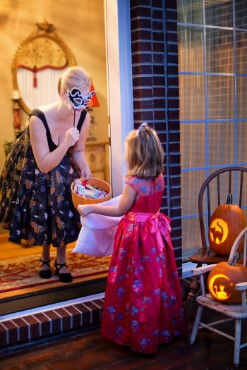 Trick or treating girl, should Halloween change its date?