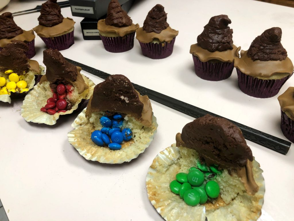 Harry Potter Sorting Hat cupcakes with M&M's in the middle.