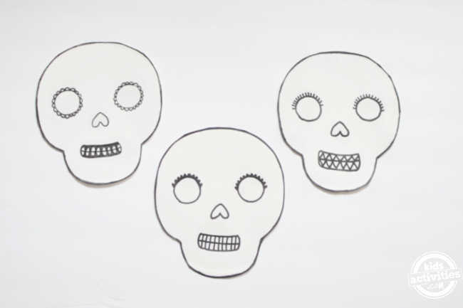 three paper plate template base displayed on a white background for decorating -paper plate masks for the day of the dead
