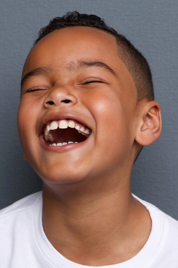 best funny jokes for kids from Kids Activities Blog - boy laughing out loud with eyes closed