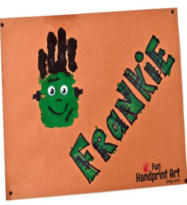cute frankenstein craft on orange paper made from brown and green paint, frankie is made from a handprint