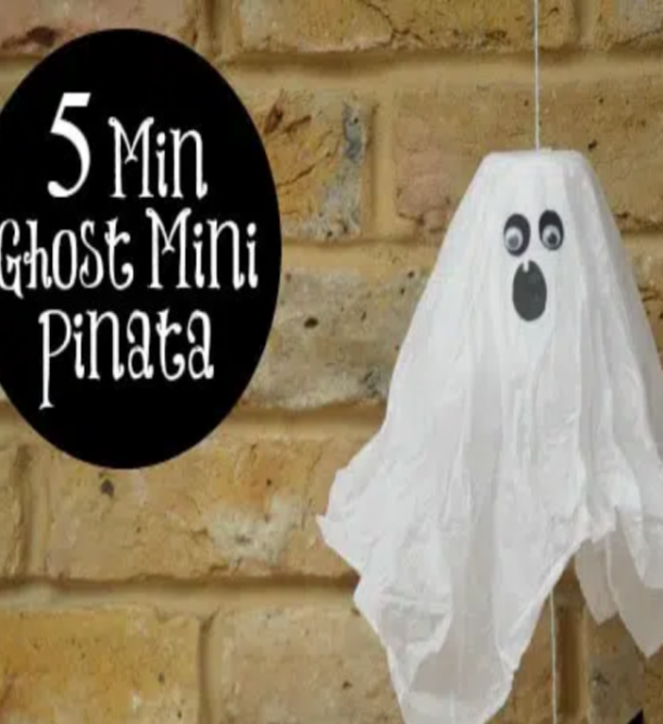 Halloween piñatas made from white cloth, black paper, and googly eyes