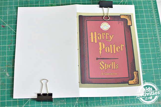list of harry potter spells printed and stacked one above the other and poked holes to bind using saddle stitch