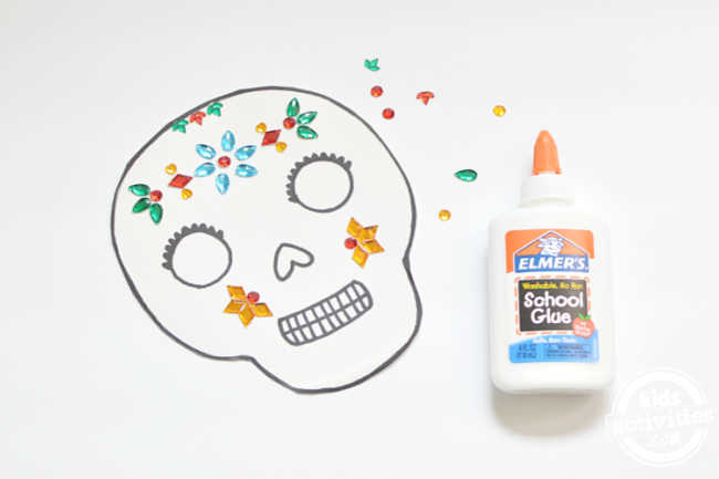 paper plate masks with rhinestones glued on with elmers school glue for calavera masks