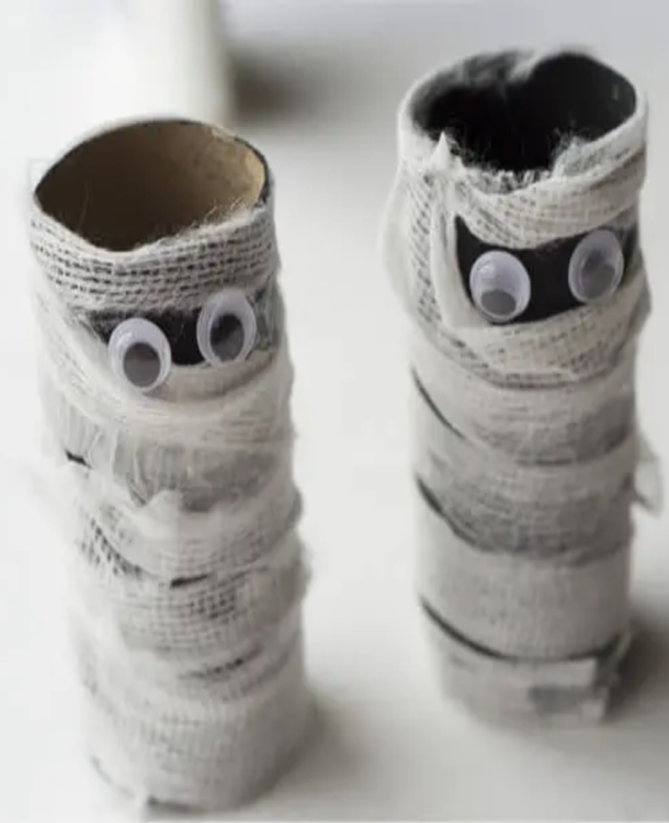 toilet paper roll mummy made with gauze, toilet paper rolls, and googly eyes