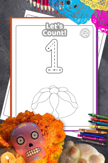 day of the dead printable coloring pages showing the number one and a loaf of pan de muerto, on a tabletop surrounded by a sugar skull, candle, marigolds, papel picado and colorful pencils and crayons