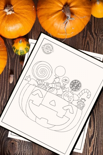 Halloween Candy Coloring Page of a jack o lantern pumpkin overflowing with candy. The coloring page is on a wooden surface surrounded by small pumpkins