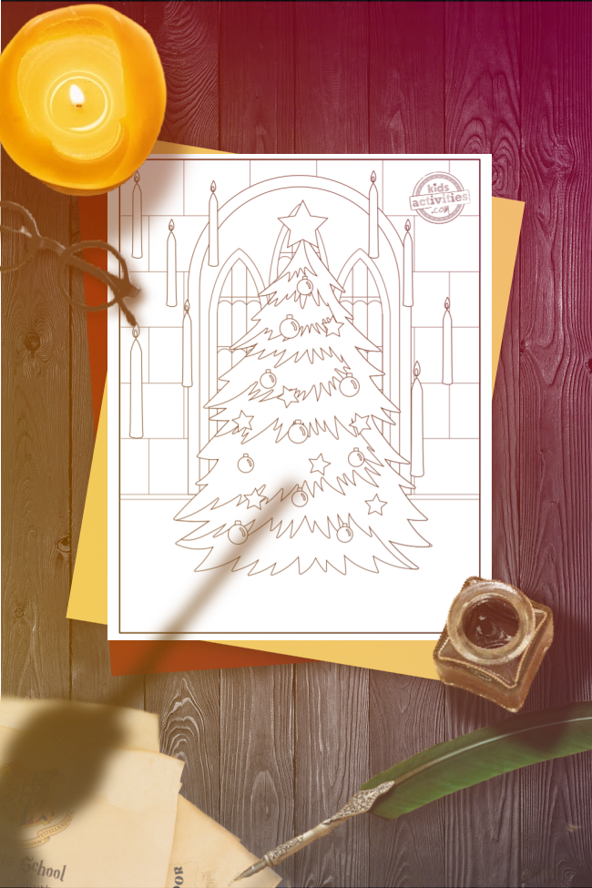 Hogwarts coloring page of a Christmas tree inside Hogwarts framed by a brick arch and surrounded by floating candles, with the coloring page shown on a wooden desk overshadowed by a wand held above.