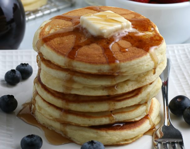 homemade pancake stack cooked from scratch with pancake mix recipe covered with syrup