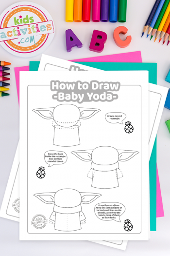 second page of the three page how to draw baby yoda tutorial worksheets on a light surface surrounded by colorful crayons, ABC and the kids activities blog logo