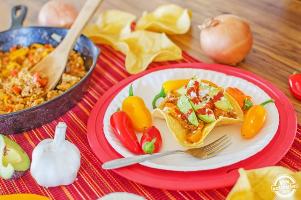 Taco Breakfast Bowls - skillet with taco breakfast bowls shown on colorful place mat