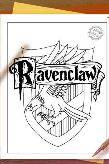 Ravenclaw coloring page of the Ravenclaw house crest on a wooden table with candle, inkpot and quill, shadowewd by someone waving a wand