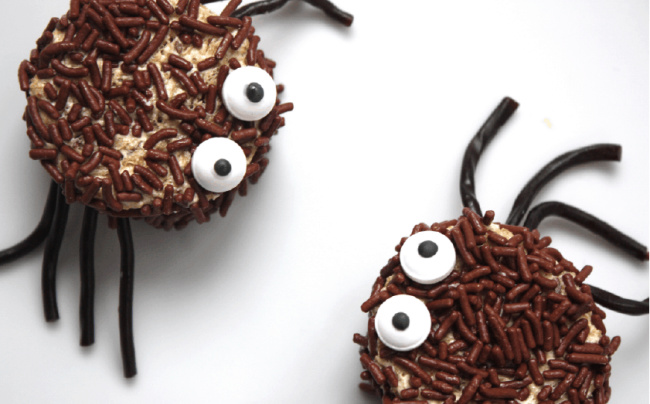 Spider sandwiches with chocolate sprinkles on a white background.