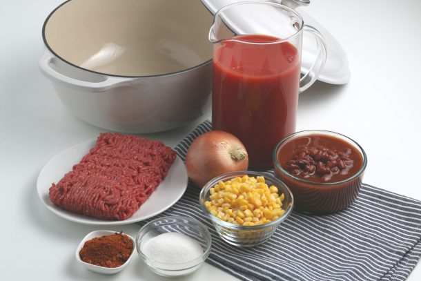 Taco Soup Recipe Ingredients on a kitchen table in bowls