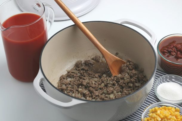 Taco Soup Recipe Step 2 - Drain the grease of the browned meat and onion mixture