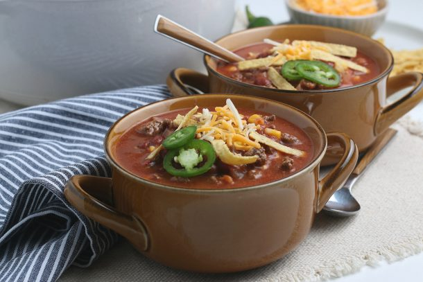 Taco Soup Recipe Step 5 - Serve with toppings - two bowls shown with taco soup and toppings