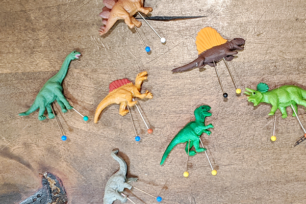 Plastic dinosaurs have pins stuck into their undersides so that they can make great terrarium decor