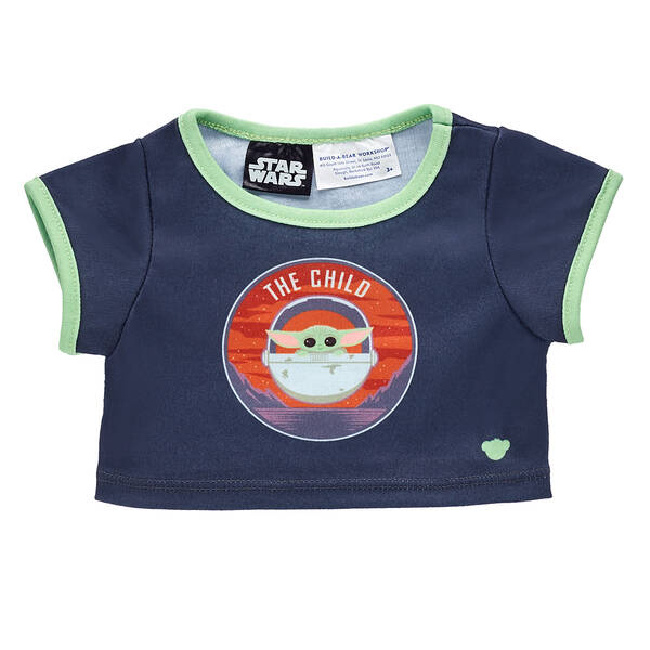 "Baby Yoda Build-A-Bear t-shirt item, dark blue with green hems and a picture of Baby Yoda in his pod with the words ""The Child"" above him."