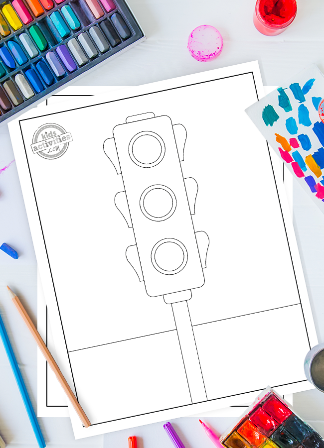 Stop signal coloring page for kids - shown is a copy of the printable Crossing signal coloring page for kids with colored pencils and paint in the background