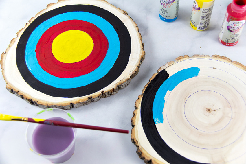 wood slices being painted like targets