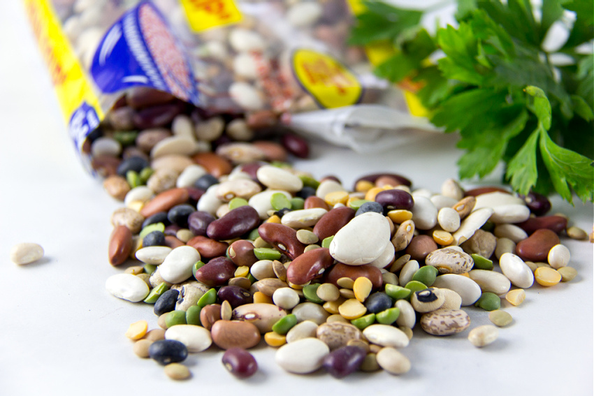 dried beans on a counter with fresh parsley
