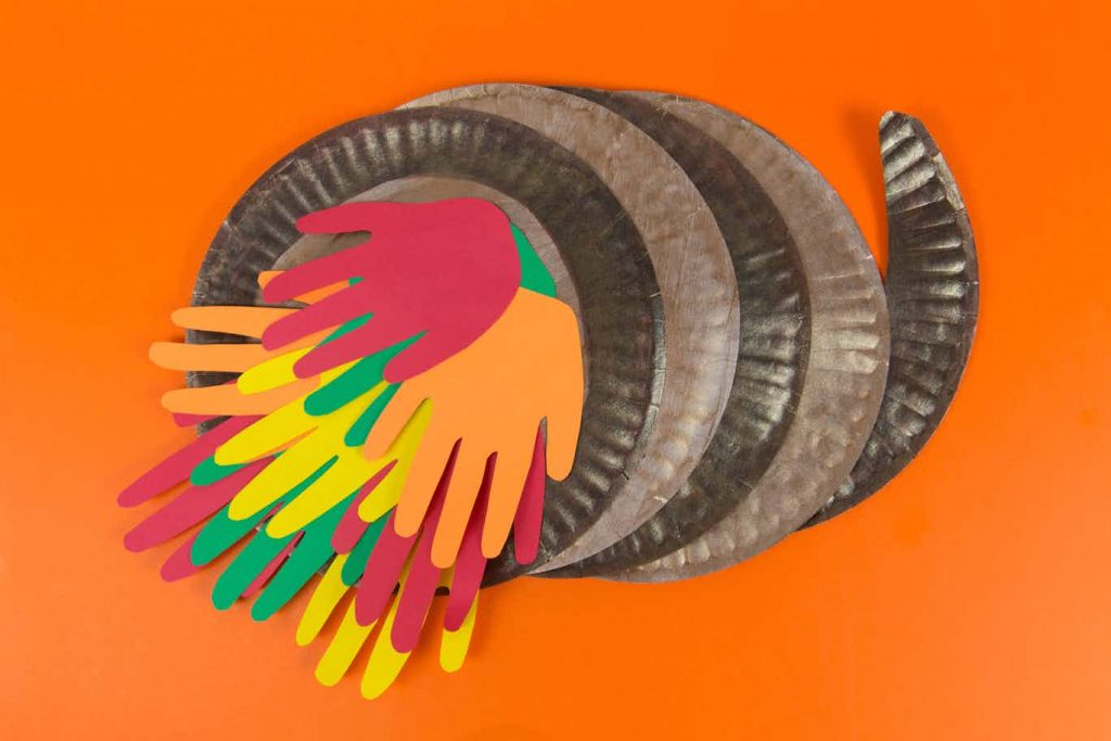 Paper plate cornucopia is filled with handprints.  What a way to give thanks!