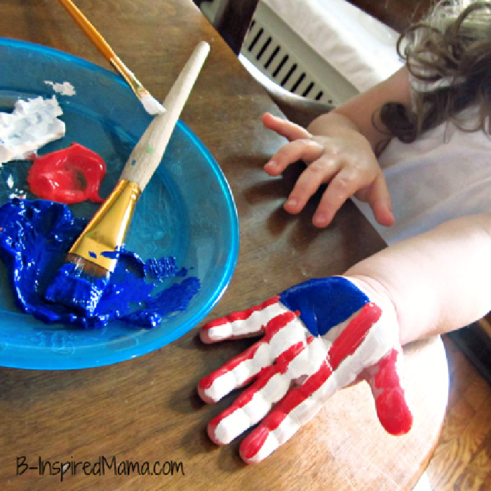 little girls hand painted with red white and blue like american flag