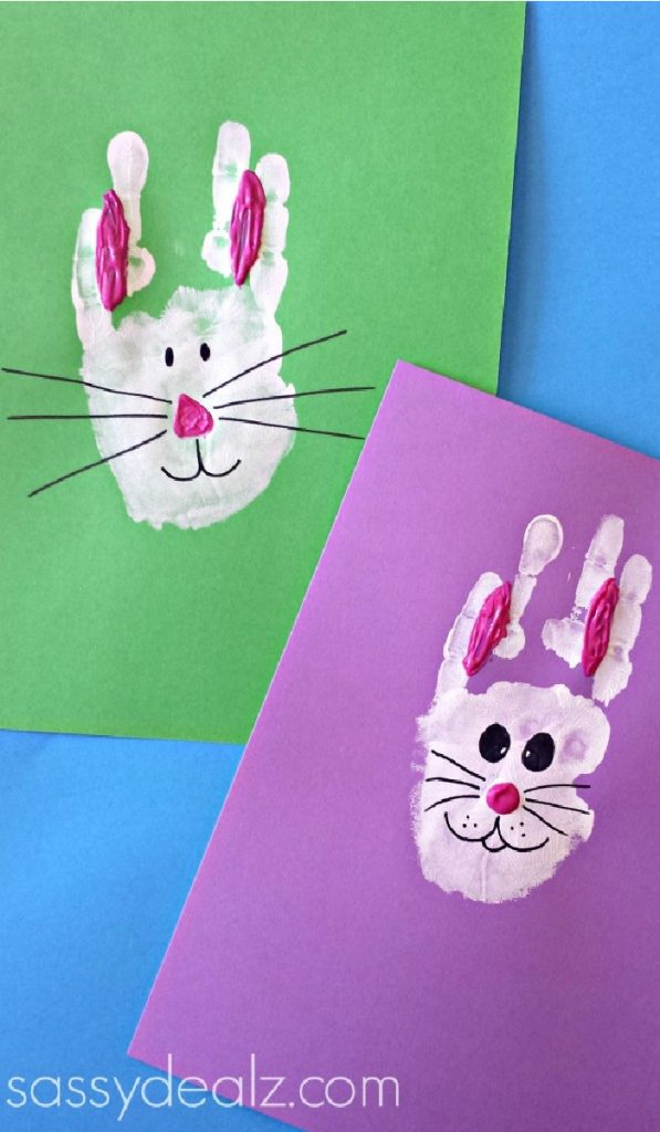 handprint bunny rabbits with pink ears on red and purple paper