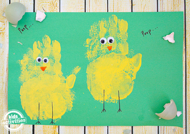 yellow handprints decorated to look like baby chicks