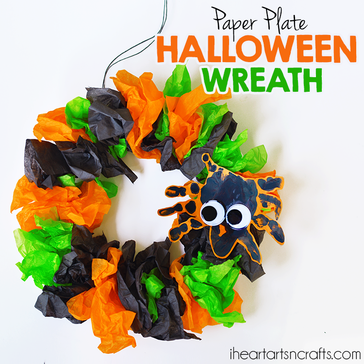 tissue paper wreath for Halloween with a handprint spider decor with big eyes